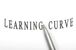 Learning curve isolated in white background with pen.