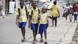 School Children walking the street.